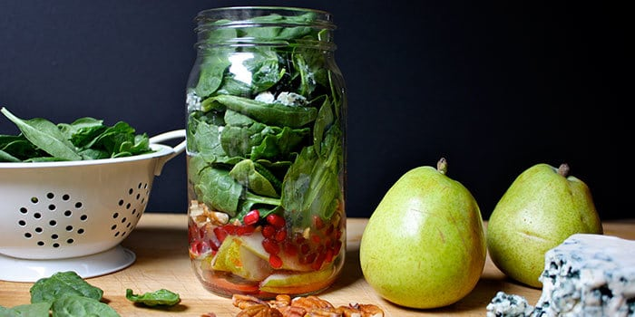 Blue cheese pear and spinach salad in a mason jar great to meal prep your lunch this week.