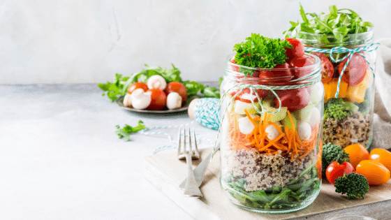 Chef salad in a jar from recipe to meal prep your lunch. A plate with some already on a plate ready to eat.