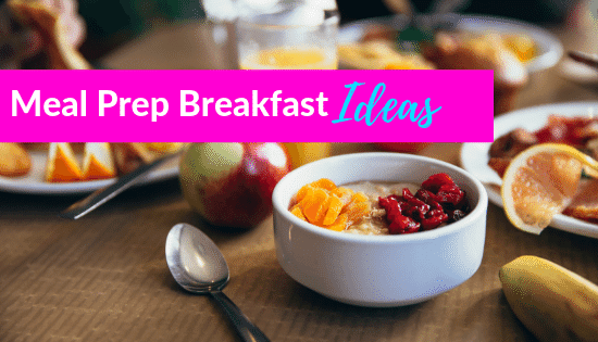 Table full of breakfast foods ready to eat such as fruit, eggs and juice. Text overlay Meal Prep Breakfast ideas.