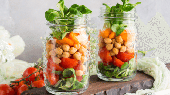 2 mason jars with rainbow salad recipe for meal prep your lunch.