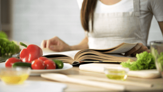 woman cooking kitchen using meal planning hacks