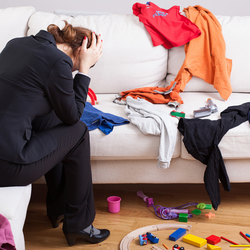 Mom frustrated living room with mess to clean up.