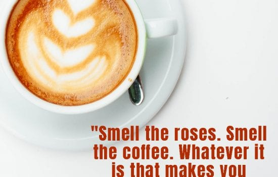 One of the December's done for you social media graphics with a cup of coffee on a white table with quote Smell the roses Smell the coffe whatever is that makes you happy.