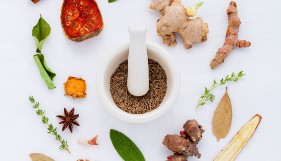 A variety of adaptogens on a table beting prepared to use for your health.