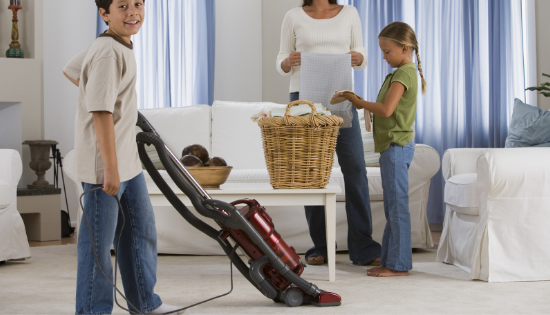 Family cleaning the livingroom together.