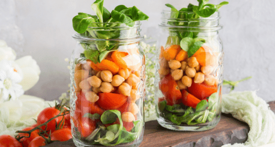 Ball Mason Jars being used for meal prep full of veggies.